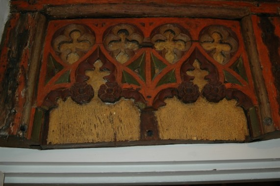 Detail of Tudor painted screen in refectory wing