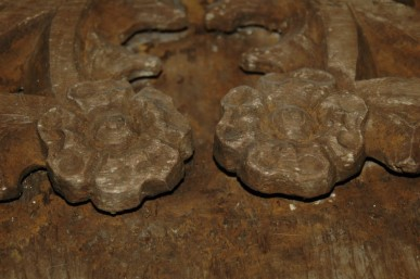 Tudor rose detail on the 15th century screen in the refectory wing