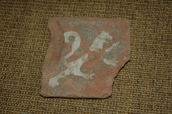 Fragment of inlaid floor tile with lion motif, 13th century. Probably made in the Exeter area