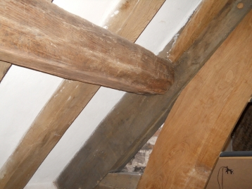 Oak roof purlin in the 15th century refectory wing
