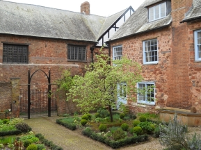 St Nicholas Priory (the guest wing) and the refectory wing (left) from the cloister garden